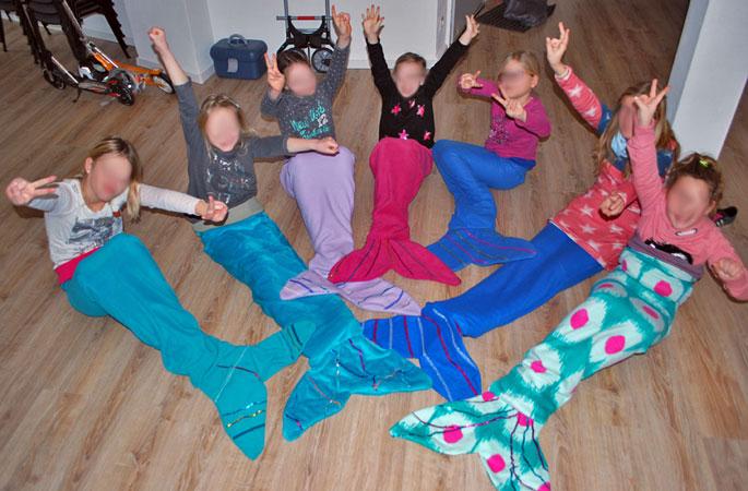 Sieben glückliche Meerjungfrauen